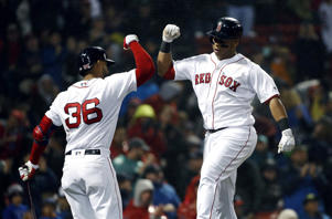 Boston Red Sox's Rafael Devers celebrates his solo home run with Eduardo Nunez (36) during the fourth inning of a baseball game against the Baltimore Orioles in Boston, Saturday, May 19, 2018. (AP Photo/Michael Dwyer)