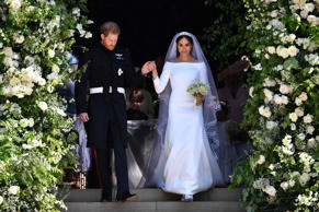Prince Harry and Meghan Markle leaving at St. George's Chapel in Windsor Castle after their wedding ceremony.