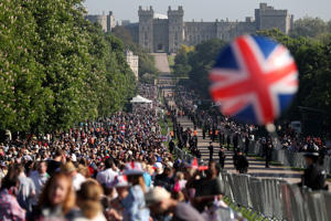 a large crowd of people standing in front of a building: This is How Much The Royal Wedding Cost