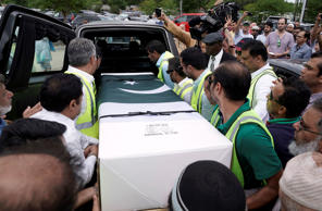 The body of Pakistani exchange student Sabika Sheikh, who was killed in the Santa Fe High School shooting, is loaded into a hearse after a service at the Brand Lane Islamic Center Sunday, May 20, 2018, in Stafford, Texas. A gunman opened fire inside Santa Fe High School, May 18, 2018, killing multiple people.