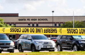SANTA FE, TX - MAY 19:   Crime scene tape surrounds  Santa Fe High School the day after a shooting where nine students and one teacher were killed . (Photo by Jonathan Newton/The Washington Post via Getty Images)