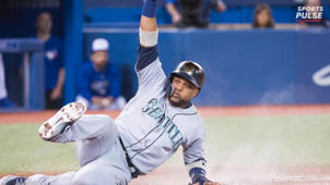 a baseball player holding a bat: MLB: Robinson Cano may cost himself a spot in Cooperstown