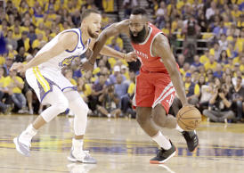 Houston Rockets guard James Harden, right, dribbles against Golden State Warriors guard Stephen Curry during the first half of Game 3 of the NBA basketball Western Conference Finals in Oakland, Calif., Sunday, May 20, 2018.