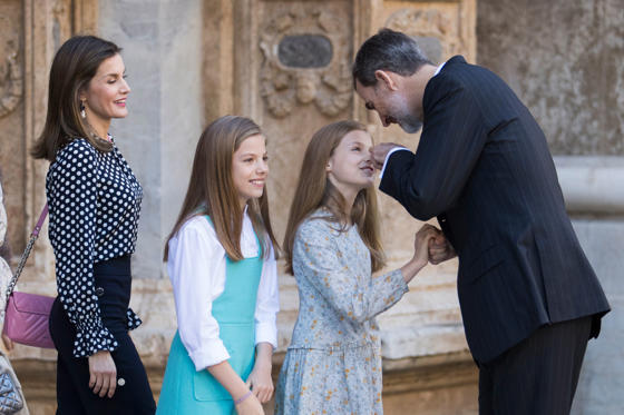 Slide 1 of 37: King Felipe VI of Spain (R) jokes with his daughters Princess Sofia (2ndL) and Princess Leonor (2ndR) next to his wife Queen Letizia (L) as they leave after attending the traditional Easter Sunday Mass of Resurrection in Palma de Mallorca on April 1, 2018.  / AFP PHOTO / JAIME REINA        (Photo credit should read JAIME REINA/AFP/Getty Images)