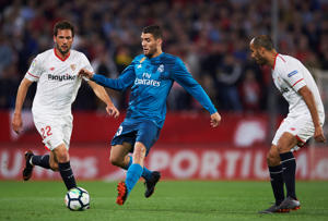 Mateo Kovacic of Real Madrid CF  competes for the ball with Franco Vazquez of Sevilla FC  during the La Liga match between Sevilla FC and Real Madrid at Ramon Sanchez Pizjuan stadium on May 9, 2018 in Seville, Spain.