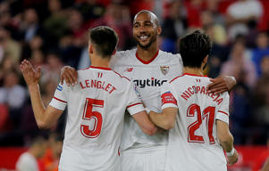 Sevilla's Clement Lenglet, Steven N'Zonzi and Nicolas Pareja celebrate after the match