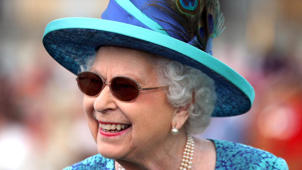 a close up of Elizabeth II wearing a hat and sunglasses: Here's How You Can Own Clothes Worn by a Royal!