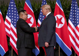 U.S. President Donald Trump shakes hands with North Korean leader Kim Jong Un at the Capella Hotel on Sentosa island in Singapore June 12, 2018. REUTERS/Jonathan Ernst TPX IMAGES OF THE DAY