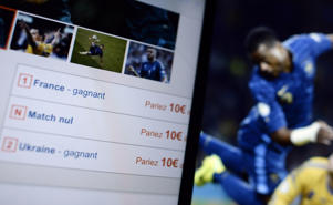 A picture shows a tablet computer's screen with a page of an online betting website on November 18, 2013 in Paris. Over 1,3 million euros in bets were recorded for the FIFA 2014 World Cup first leg playoff between Ukraine and France on November 15, 2013, the French Regulatory authority for online games ('Autorité de régulation des jeux en ligne -Arjel) announced on November 18.    AFP PHOTO / FRANCK FIFE         (Photo credit should read FRANCK FIFE/AFP/Getty Images)