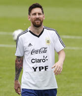 Lionel Messi of Argentina looks on during a training session at the team base camp.