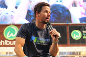Mark Wahlberg greets fans at the grand opening of their Wahlburger restaurant at Mall of America on May 31, 2018 in Bloomington, Minnesota. (Photo by Adam Bettcher/Getty Images)