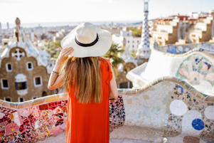 Tourist enjoying the view from Guell park.
