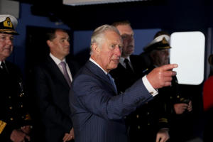 The Prince of Wales aboard a simulator at the National Maritime College of Ireland as part of his tour of the Republic of Ireland.