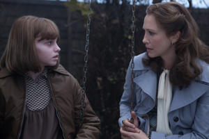 Sterling Jerins and Vera Farmiga in The Conjuring 2.