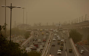 City skyline seen engulfed with thick dust particles at Akshardham flyover