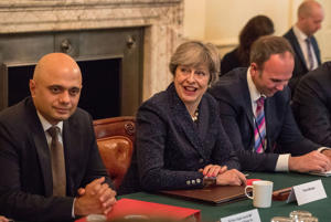 Britain's Prime Minister Theresa May, (C), with Britain's Communities and Local Government Secretary Sajid Javid (L) and Chief of Staff Gavin Barwell, hosts a roundtable meeting about housing supply at 10 Downing Street