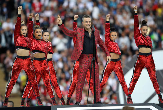 Slide 1 of 31: Soccer Football - World Cup - Opening Ceremony - Luzhniki Stadium, Moscow, Russia - June 14, 2018   Robbie Williams performs during the opening ceremony   REUTERS/Carl Recine