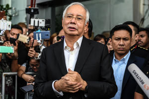 Malaysia's former prime minister Najib Razak speaks to the media after being questioned at the Malaysian Anti-Corruption Commission (MACC) office in Putrajaya on May 24, 2018. - Najib arrived at the anti-graft agency on May 24 to be questioned for a second time this week over a multi-billion-dollar corruption scandal following his shock election loss. (Photo by Mohd RASFAN / AFP)        (Photo credit should read MOHD RASFAN/AFP/Getty Images)