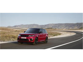 a car driving on a road: 2018 Land Rover Range Rover Sport