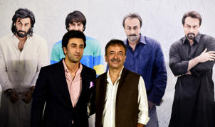 Indian Bollywood actor Ranbir Kapoor (L) poses for a picture with film Director Rajkumar Hirani  during the teaser launch of his upcoming Indian biographical drama Hindi film 'Sanju', based on the life of Bollywood actor Sanjay Dutt, in Mumbai on April 24, 2018. (Photo by - / AFP)        (Photo credit should read -/AFP/Getty Images)