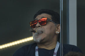 Argentina's football legend Diego Maradona smokes a cigare as he attends the Russia 2018 World Cup Group D football match between Argentina and Iceland at the Spartak Stadium