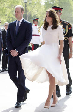 Slide 2 of 34: Kate Middleton wearing an Emilia Wickstead dress.