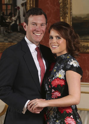 Britain's Princess Eugenie and Jack Brooksbank pose for the media after they announced their engagement in London on Jan. 22, 2018.