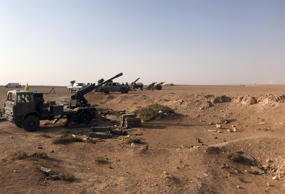 Artillery are seen lined up in the village of Suway'iah, near the Syrian border town of Albu Kamal, on November 10, 2017.