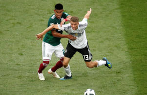 Germany's Thomas Muller in action with Mexico's Hugo Ayala.