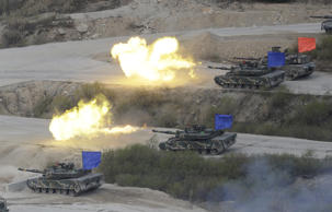 South Korean army's K1A2 tanks fire during a South Korea-U.S. joint military live-fire drills at Seungjin Fire Training Field in Pocheon, South Korea, near the border with the North Korea, Wednesday. April 26, 2017.