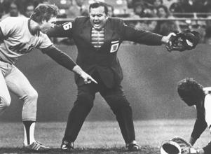 * New York Mets' John Stearns, left, points out to home plate umpire Dutch Rennert, center, that he was safe because the San Francisco Giants catcher didn't hold on to the ball in this July 25, 1979 file photo in San Francisco. Rennert, the little ump with the big voice, made a rare appearance at the ballpark in spring training. One look at him brought to mind his signature call: ``STRIIIIIKE THREEEEEEEEEEE!!!''