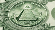 """Annuit Coeptis,"" which is written above the pyramid, means ""Providence Has Favored Our Undertakings."" Below the pyramid, the words ""Novus ordo seclorum"" mean ""A New Order of the Ages,"" which refers to the United States' historic form of government."