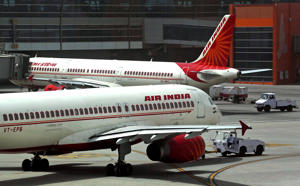 "Air India planes are parked on the tarmac at the Terminal 3 of Indira Gandhi International Airport in New Delhi, India. India's federal cabinet has approved a plan to privatise its debt-ridden national carrier Air India. A statement from the finance ministry Wednesday, June 28, 2017, said that the government had given ""in principle"" approval to sell disinvest from the troubled airline which has struggled to emerge from the red as competition from a number of low-cost airlines has grown. (AP Photo/Kevin Frayer, File)"
