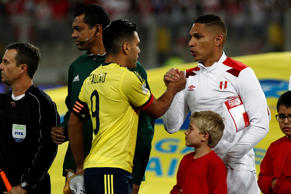 LIMA, PERU - OCTOBER 10: Paolo Guerrero of Peru (R) greets Radamel Falcao of Colombia (L) before the match between Peru and Colombia as part of FIFA 2018 World Cup Qualifiers at National Stadium on October 10, 2017 in Lima, Peru. (Photo by Leonardo Fernandez/Getty Images)