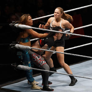 PARIS, FRANCE - MAY 19:  Ronda Rousey (R) in action vs Mickie James (L ) and Ruby Riott during WWE Live AccorHotels Arena Popb Paris Bercy on May 19, 2018 in Paris, France.  (Photo by Sylvain Lefevre/Getty Images)