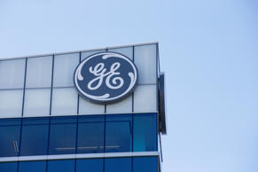 The General Electric logo is displayed at the top of their Global Operations Center, Tuesday, Jan. 16, 2018, in the Banks development of downtown Cincinnati. GE CEO John Flannery, who was put in charge of reviving the company last summer, revealed significant issues at GE Capital on Tuesday, which will lead to a $6.2 billion after-tax charge in the fourth quarter.