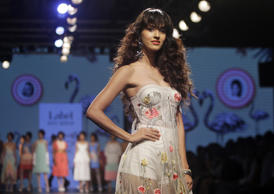 Bollywood actress Disha Patani displays a creation by Ritu Kumar during the Lakme Fashion Week in Mumbai, India, Wednesday, Aug. 16, 2017. (AP Photo/Rajanish Kakade)