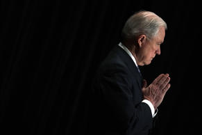U.S. Attorney General Jeff Sessions listens as he is introduced during the Justice Department's Executive Officer for Immigration Review (EOIR) Annual Legal Training Program June 11, 2018 at the Sheraton Tysons Hotel in Tysons, Virginia. Sessions spoke on his intention to limit reasons for people to claim asylum in the U.S.