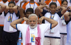 Indian Prime Minister Narendra Modi, center, performs yoga with thousands of Indians to mark international yoga day in Lucknow, India, Wednesday, June 21, 2017. Millions of yoga enthusiasts across India take part in a mass yoga sessions to mark the third International Yoga Day which falls on June 21 every year. (AP Photo/Rajesh Kumar Singh)