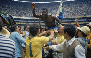 In this June 21, 1970 file photo, Brazil's Pele, center, is hoisted on the shoulders of his teammates after Brazil won the World Cup soccer final against Italy, 4-1, in Mexico City's Estadio Azteca, Mexico.