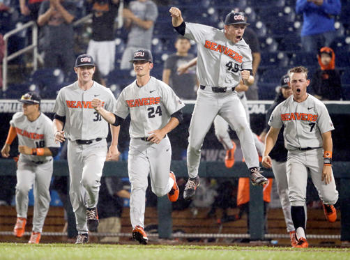 Slide 1 of 16: Oregon State players celebrate after the final out against North Carolina in an NCAA College World Series baseball elimination game in Omaha, Neb., Wednesday, June 20, 2018. Oregon State won 11-6.