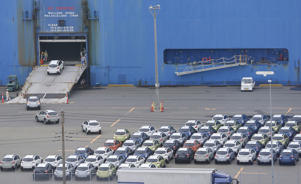 a car is lined up in a parking lot: Trump Administration Tariffs Could Boost Car Prices, Limit Choices
