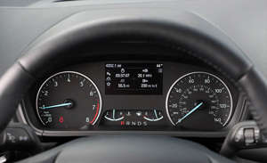 a clock is shown at the time: Fuel Economy and Driving Range