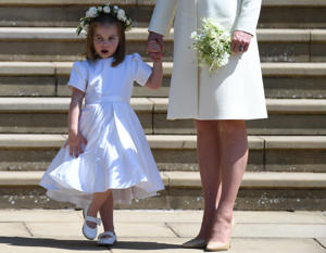Britain's Princess Charlotte (L) leaves St George's Chapel in Windsor Castle after the royal wedding ceremony of Prince Harry, Duke of Sussex and Meghan, Duchess of Sussex in Windsor, Britain, 19 May 2018. The couple have been bestowed the royal titles of Duke and Duchess of Sussex on them by the British monarch.  NEIL HALL/Pool via REUTERS