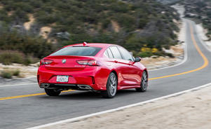 a red car driving on a road: 2018 Buick Regal GS Tested: Grand Sport or Bland Sport?