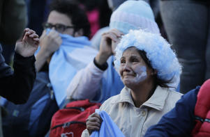 Argentina fans react in disbelief at the end of a televised broadcast of the Croatia vs Argentina World Cup soccer match, in Buenos Aires, Argentina, Thursday, June 21, 2018. Argentina lost 3-0 to Croatia. (AP Photo Jorge Saenz)