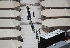 Children and workers are seen at a tent encampment near the Tornillo Port of Entry in Tornillo, Texas. The Trump administration is using the Tornillo tent facility to house immigrant children separated from their parents after they were caught entering the U.S. under the administration's zero tolerance policy.