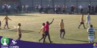Referee shows football's first ever green card to discipline player