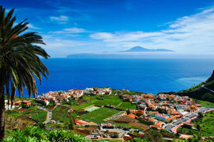View of village of Agulo on La Gomera and neighboring island of Tenerife, Spain.