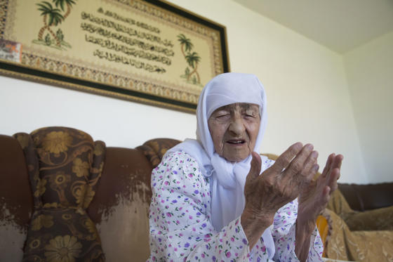 Slide 2 of 28: CAPTION: GROZNY, RUSSIA - MAY 16, 2018: 128-year-old Koka Istambulova at her house in the village of Bratskoye, Nadterechny District, Chechen Republic. Istambulova, born in 1889, is Russia's oldest person. Yelena Afonina/TASS (Photo by Yelena Afonina\TASS via Getty Images)